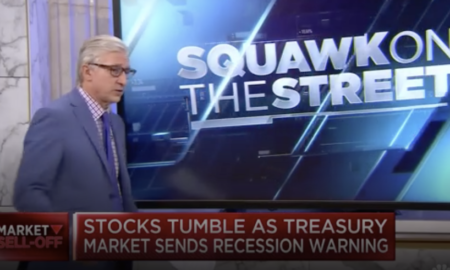 Dow plunges over 650 points - bond market flashes recession warning